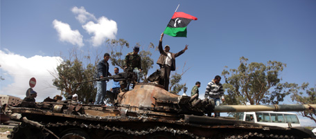 Libyan rebels wave their flag on top of
